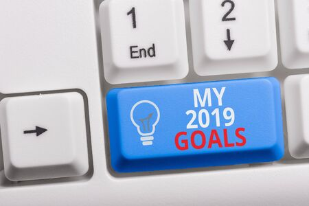 Writing note showing My 2019 Goals. Business concept for setting up demonstratingal goals or plans for the current year Keyboard with note paper on white background key copy space