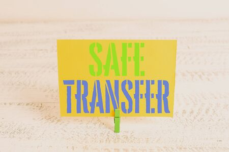 Text sign showing Safe Transfer. Business photo showcasing Wire Transfers electronically Not paper based Transaction Green clothespin white wood background colored paper reminder office supply