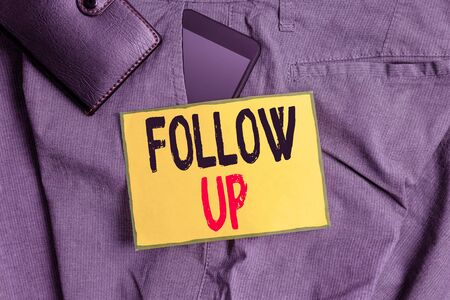 Conceptual hand writing showing Follow Up. Concept meaning a continuation of something that has already been started Smartphone device inside trousers front pocket with wallet
