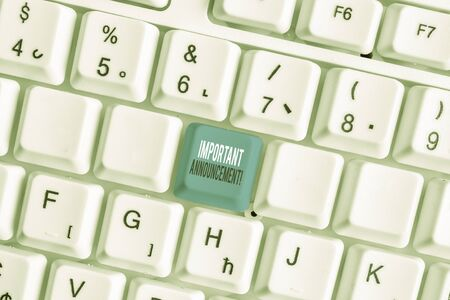 Writing note showing Important Announcement. Business concept for spoken statement that tells showing about something White pc keyboard with note paper above the white background Stock Photo