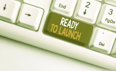 Text sign showing Ready To Launch. Business photo showcasing an event to celebrate or introduce something new to market White pc keyboard with empty note paper above white background key copy space