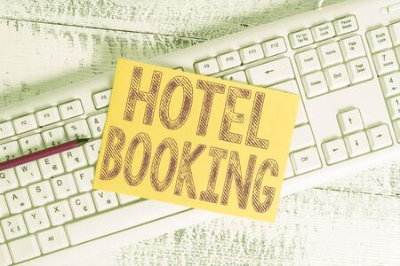 Text sign showing Hotel Booking. Business photo showcasing Online Reservations Presidential Suite De Luxe Hospitality White keyboard office supplies empty rectangle shaped paper reminder wood Фото со стока