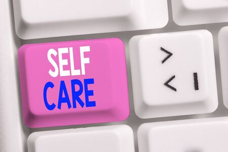 Handwriting text writing Self Care. Conceptual photo the practice of taking action to improve one s is own health White pc keyboard with empty note paper above white background key copy space
