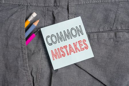 Handwriting text Common Mistakes. Conceptual photo actions that are often used interchangeably with error Writing equipment and blue note paper inside pocket of man work trousers