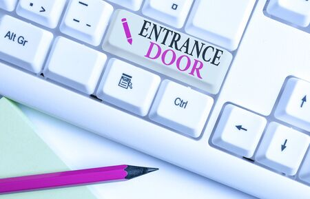 Handwriting text writing Entrance Door. Conceptual photo Way in Doorway Gate Entry Incoming Ingress Passage Portal White pc keyboard with empty note paper above white background key copy space