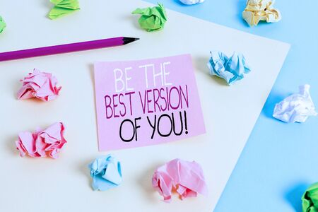 Writing note showing Be The Best Version Of You. Business concept for going to move away from where are start improving Colored crumpled papers empty reminder blue yellow clothespin