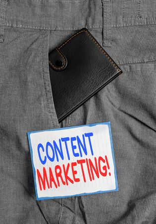 Handwriting text Content Marketing. Conceptual photo involves creation and sharing of online material Small little wallet inside man trousers front pocket near notation paper