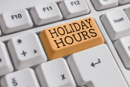 Conceptual hand writing showing Holiday Hours. Concept meaning Schedule 24 or7 Half Day Today Last Minute Late Closing White pc keyboard with note paper above the white background