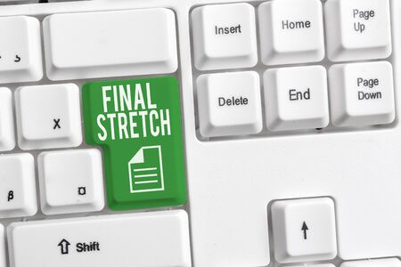 Conceptual hand writing showing Final Stretch. Concept meaning Last Leg Concluding Round Ultimate Stage Finale Year ender White pc keyboard with note paper above the white background
