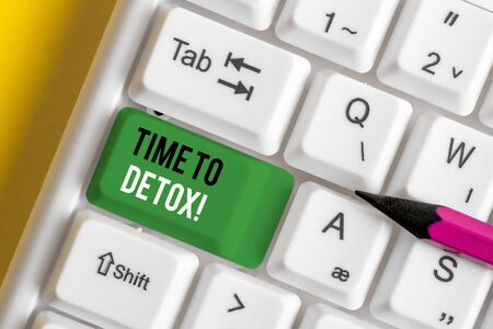 Writing note showing Time To Detox. Business concept for when you purify your body of toxins or stop consuming drug White pc keyboard with note paper above the white background