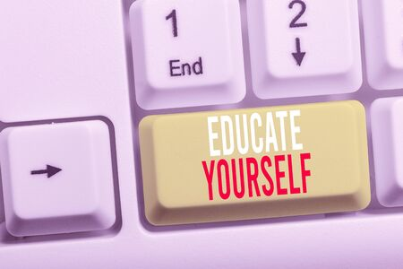 Writing note showing Educate Yourself. Business concept for prepare oneself or someone in a particular area or subject White pc keyboard with note paper above the white background Stock Photo