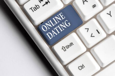 Text sign showing Online Dating. Business photo text Searching Matching Relationships eDating Video Chatting White pc keyboard with empty note paper above white background key copy space