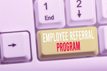 Writing note showing Employee Referral Program. Business concept for employees are rewarded for introducing recruits White pc keyboard with note paper above the white background