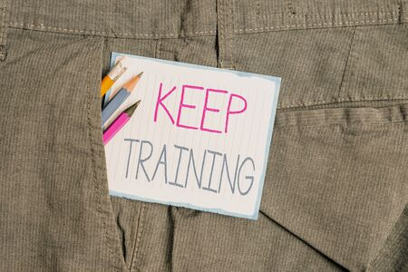 Handwriting text Keep Training. Conceptual photo Grounding Drilling Always Wonder Be Curious Learn Writing equipment and white note paper inside pocket of man work trousers