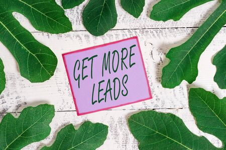Writing note showing Get More Leads. Business concept for to have more customers and improve your target sales Stock Photo