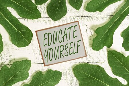 Writing note showing Educate Yourself. Business concept for prepare oneself or someone in a particular area or subject Stock Photo - 129852759
