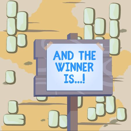 Word writing text And The Winner Is. Business photo showcasing announcing who got first place at competition or exam Wood plank wooden stick pole paper note attached adhesive tape empty space