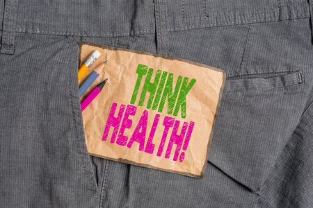 Handwriting text writing Think Health. Conceptual photo state of complete physical mental and social well being Writing equipment and brown note paper inside pocket of man work trousers