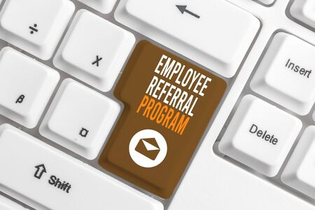 Conceptual hand writing showing Employee Referral Program. Concept meaning employees are rewarded for introducing recruits White pc keyboard with note paper above the white background Stock Photo