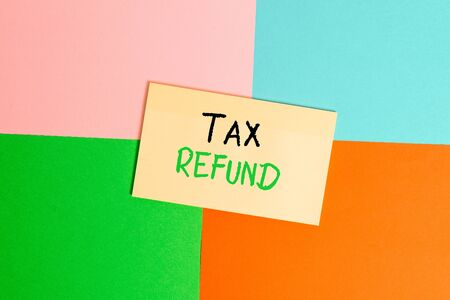 Text sign showing Tax Refund. Business photo text refund on tax when the tax liability is less than the tax paid Office appliance colorful square desk study supplies empty paper sticker Stock Photo