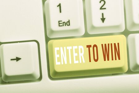 Writing note showing Enter To Win. Business concept for exchanging something value for prize or chance of winning White pc keyboard with note paper above the white background Фото со стока