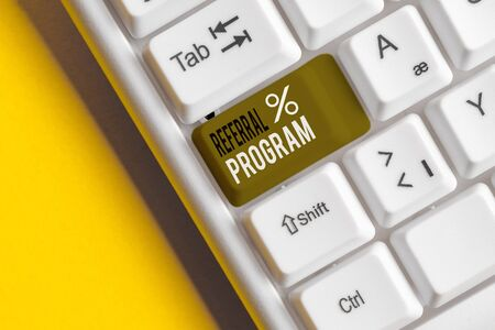 Text sign showing Referral Program. Business photo showcasing employees are rewarded for introducing suitable recruits White pc keyboard with empty note paper above white background key copy space