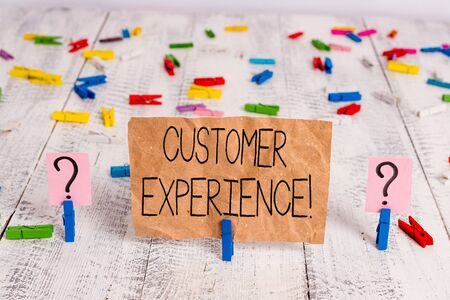 Text sign showing Customer Experience. Business photo text product of interaction between organization and buyer Scribbled and crumbling sheet with paper clips placed on the wooden table 스톡 콘텐츠