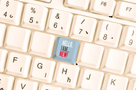 Writing note showing Hello I Am New. Business concept for used greeting or begin telephone conversation White pc keyboard with note paper above the white background Zdjęcie Seryjne