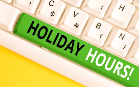 Word writing text Holiday Hours. Business photo showcasing Overtime work on for employees under flexible work schedules White pc keyboard with empty note paper above white background key copy space