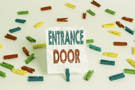 Text sign showing Entrance Door. Business photo showcasing Way in Doorway Gate Entry Incoming Ingress Passage Portal Colored clothespin papers empty reminder white floor background office