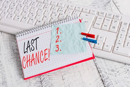 Text sign showing Last Chance. Business photo showcasing final opportunity to achieve or acquire something you want notebook paper reminder clothespin pinned sheet white keyboard light wooden Imagens