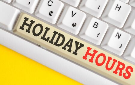 Text sign showing Holiday Hours. Business photo text Schedule 24 or7 Half Day Today Last Minute Late Closing White pc keyboard with empty note paper above white background key copy space