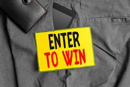 Conceptual hand writing showing Enter To Win. Concept meaning exchanging something value for prize or chance of winning Smartphone device inside trousers front pocket with wallet