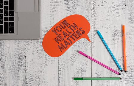 Handwriting text writing Your Health Matters. Conceptual photo good health is most important among other things Open laptop blank speech bubble pens ballpoints lying vintage wooden table