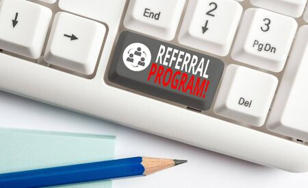 Handwriting text writing Referral Program. Conceptual photo internal recruitment method employed by organizations White pc keyboard with empty note paper above white background key copy space Stock Photo