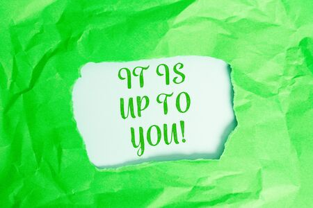 Text sign showing It Is Up To You. Business photo text Used to tell a demonstrating that they are the one to decide Green crumpled ripped colored paper sheet centre torn colorful background 写真素材 - 129852193