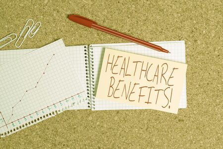Word writing text Healthcare Benefits. Business photo showcasing monthly fair market valueprovided to Employee dependents Desk notebook paper office cardboard paperboard study supplies table chart