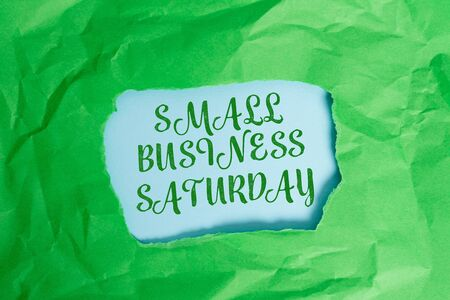 Text sign showing Small Business Saturday. Business photo text American shopping holiday held during the Saturday Green crumpled ripped colored paper sheet centre torn colorful background