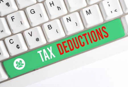 Writing note showing Tax Deductions. Business concept for an amount or cost that subtracted from someone s is income White pc keyboard with note paper above the white background