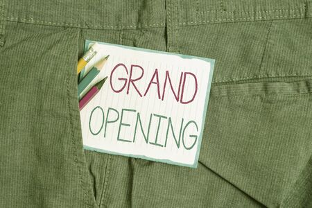 Handwriting text Grand Opening. Conceptual photo Ribbon Cutting New Business First Official Day Launching Writing equipment and white note paper inside pocket of man work trousers Imagens