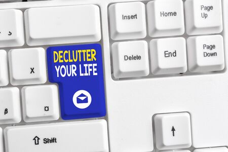 Word writing text Declutter Your Life. Business photo showcasing To eliminate extraneous things or information in life White pc keyboard with empty note paper above white background key copy space