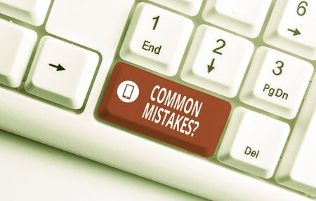 Text sign showing Common Mistakes Question. Business photo text repeat act or judgement misguided making something wrong White pc keyboard with empty note paper above white background key copy space
