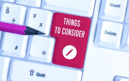 Writing note showing Things To Consider. Business concept for think about carefully especially in making decisions White pc keyboard with note paper above the white background Imagens