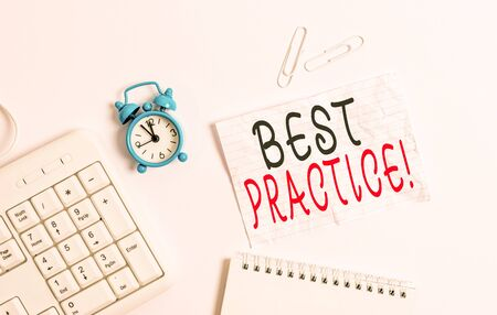 Writing note showing Best Practice. Business concept for commercial procedures that are accepted prescribed being correct Blank paper with copy space on the table with clock and pc keyboard