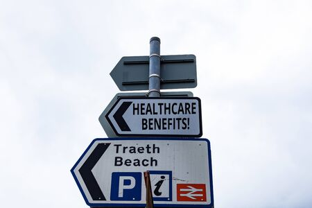 Writing note showing Healthcare Benefits. Business concept for monthly fair market valueprovided to Employee dependents Business concept with empty copy space on the road sign 写真素材 - 129851944