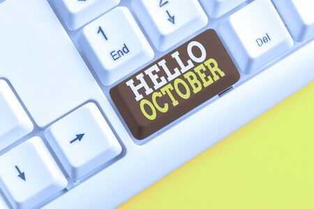 Word writing text Hello October. Business photo showcasing Last Quarter Tenth Month 30days Season Greeting White pc keyboard with empty note paper above white background key copy space Imagens