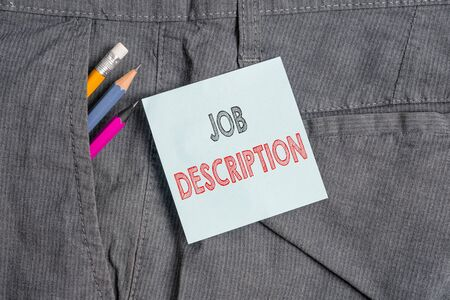 Handwriting text Job Description. Conceptual photo a formal account of an employee s is responsibilities Writing equipment and blue note paper inside pocket of man work trousers Stock Photo - 129851879