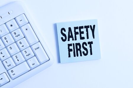 Word writing text Safety First. Business photo showcasing used to say that the most important thing is to be safe White pc keyboard with empty note paper above white background