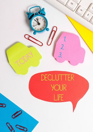 Word writing text De Clutter Your Life. Business photo showcasing remove unnecessary items from untidy or overcrowded places Flat lay with copy space on bubble paper clock and paper clips