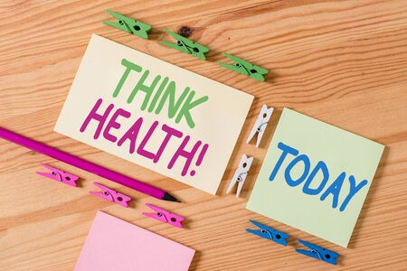 Handwriting text Think Health. Conceptual photo state of complete physical mental and social well being Colored clothespin papers empty reminder wooden floor background office